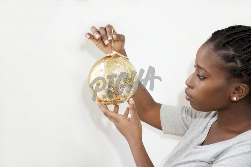 Woman holding Christmas decoration