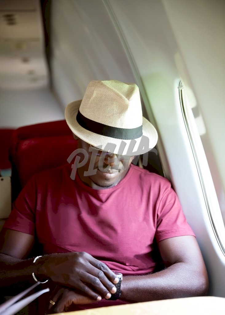 Man looking at his watch on the plane