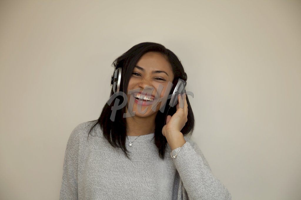 Woman listening to music laughing