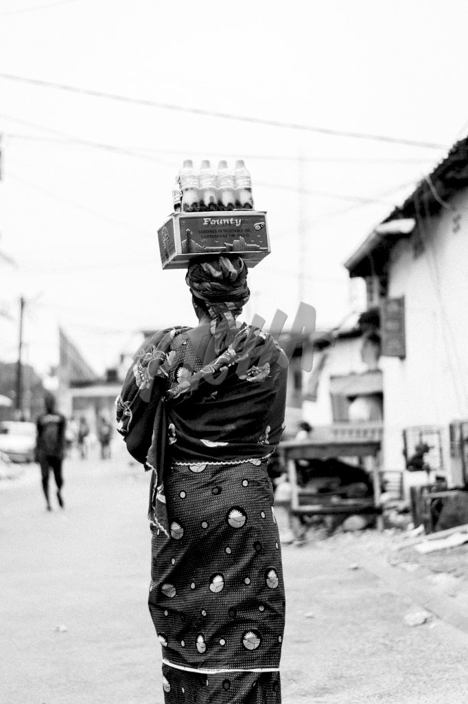 Woman carrying goods