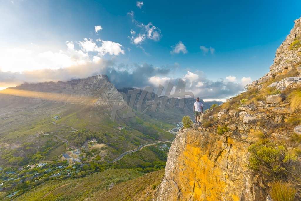 Man standing on edge of mountain, South Africa