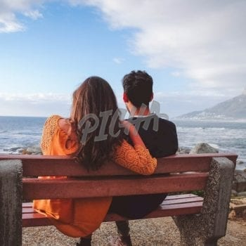 Couple looking at sea and mountain