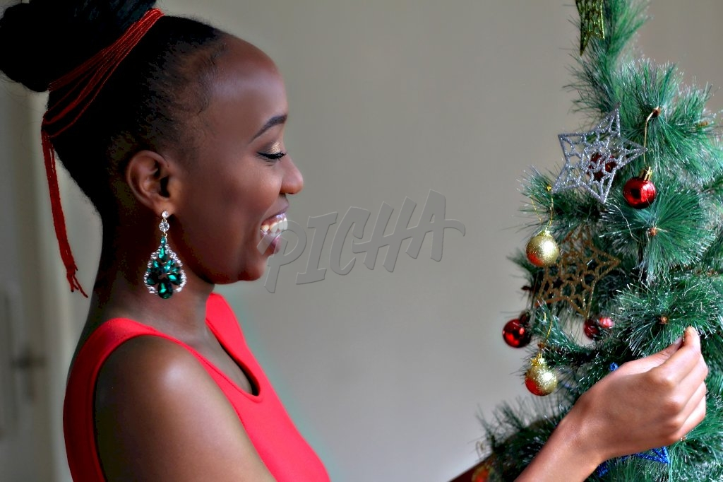 Woman arranging a Christmas tree