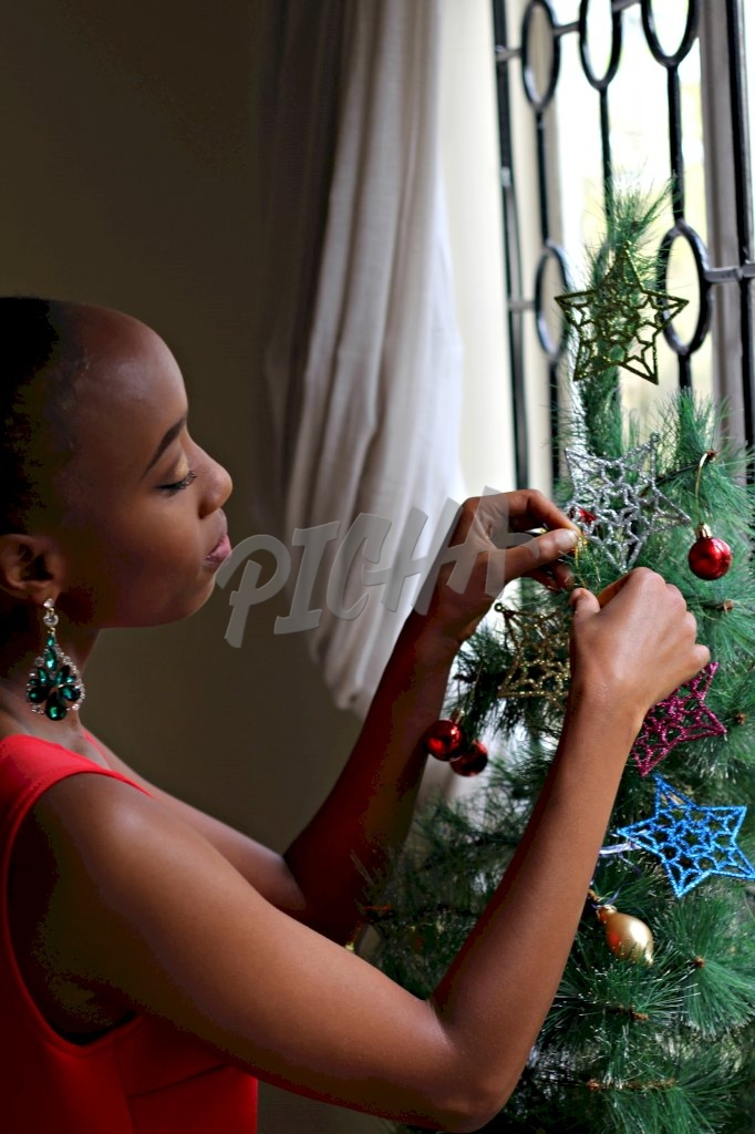 Adding decorations to Christmas tree