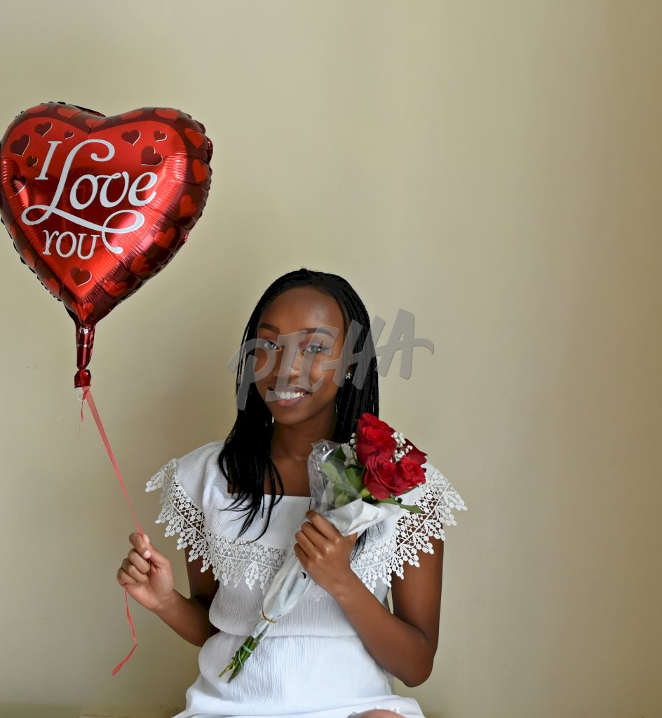 A young woman happy about valentine's day