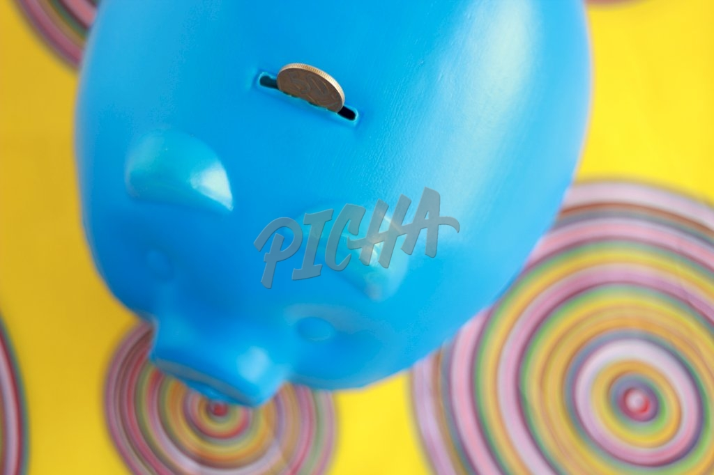 Saving in Blue Piggy Bank