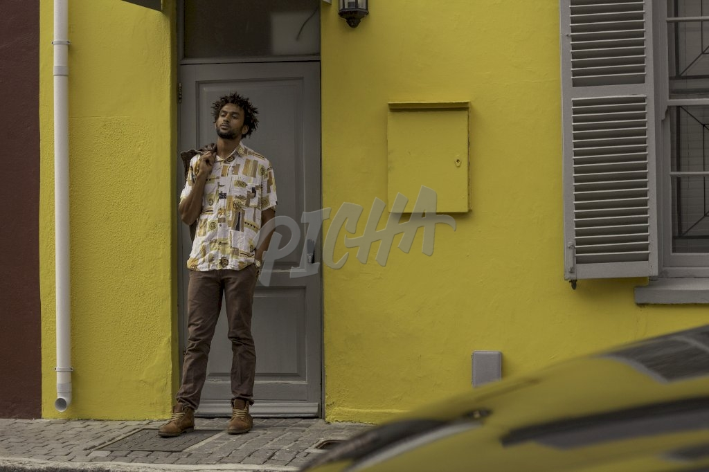 Man standing in front of his house
