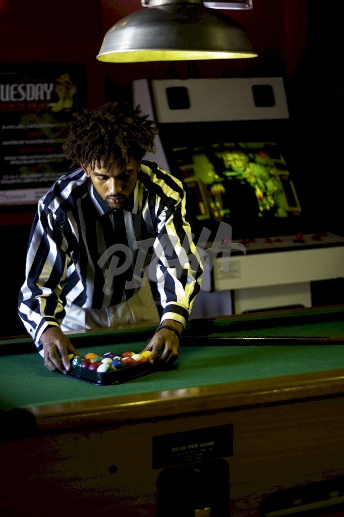 Cape Town man playing Snooker in a sports bar