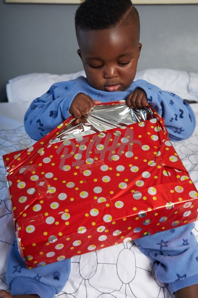 Boy opening a gift