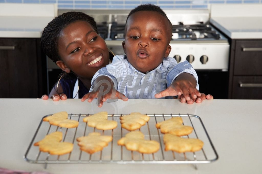 Mother baking with little boy