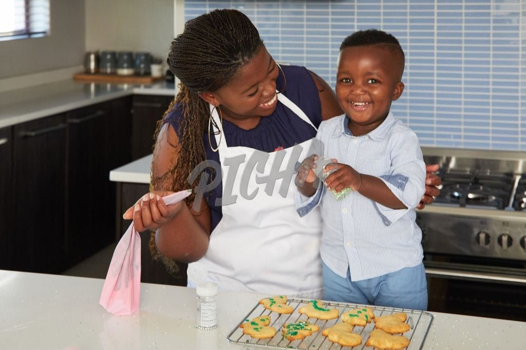 Woman baking with son