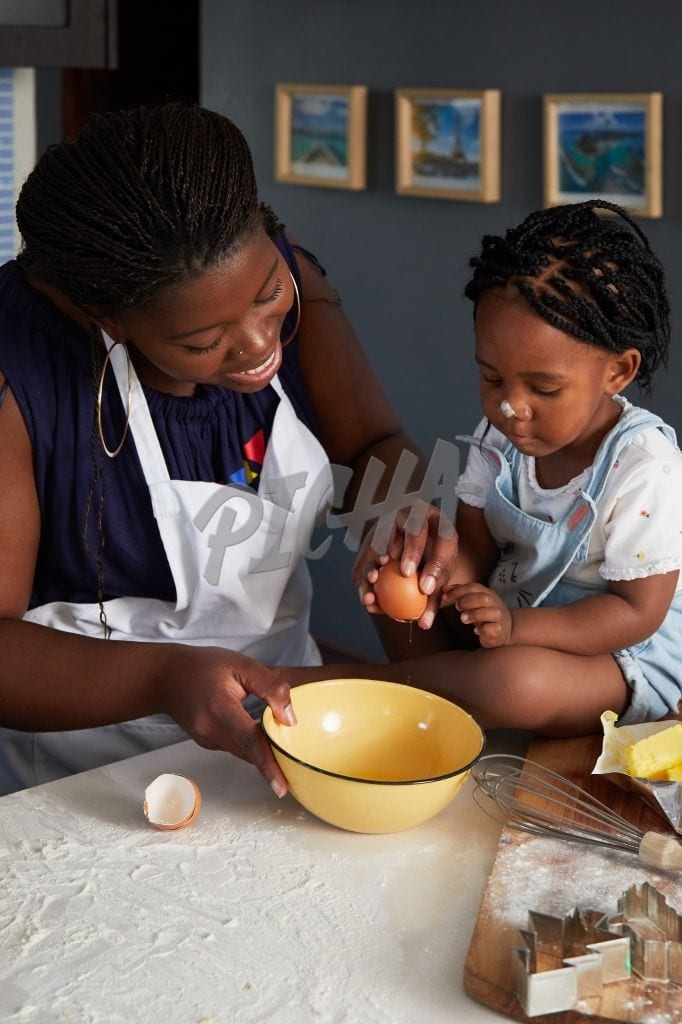 Mother baking with little girl