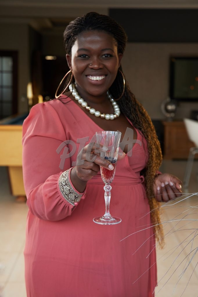 Woman holding a glass of champagne