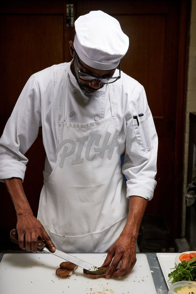 Chef holding bread