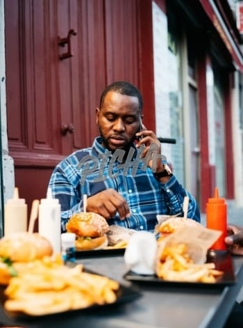 Man on the phone at a restaurant