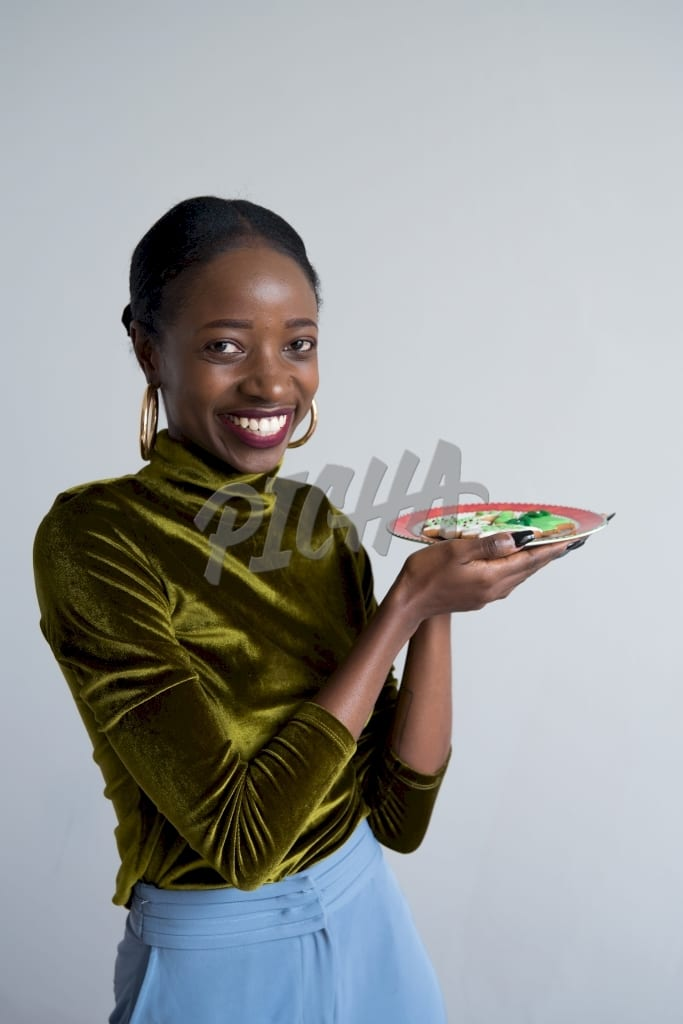 Woman holding a plate of cookies
