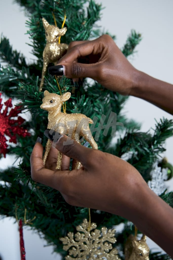 Adding an ornament to the Christmas tree