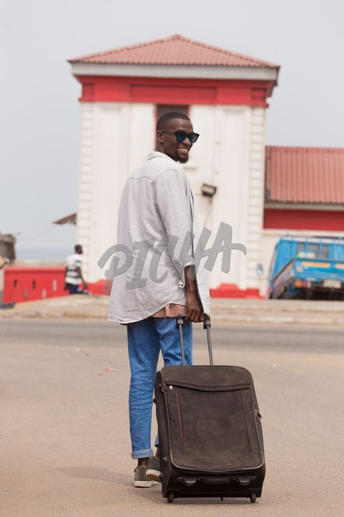 Man pulling a suitcase
