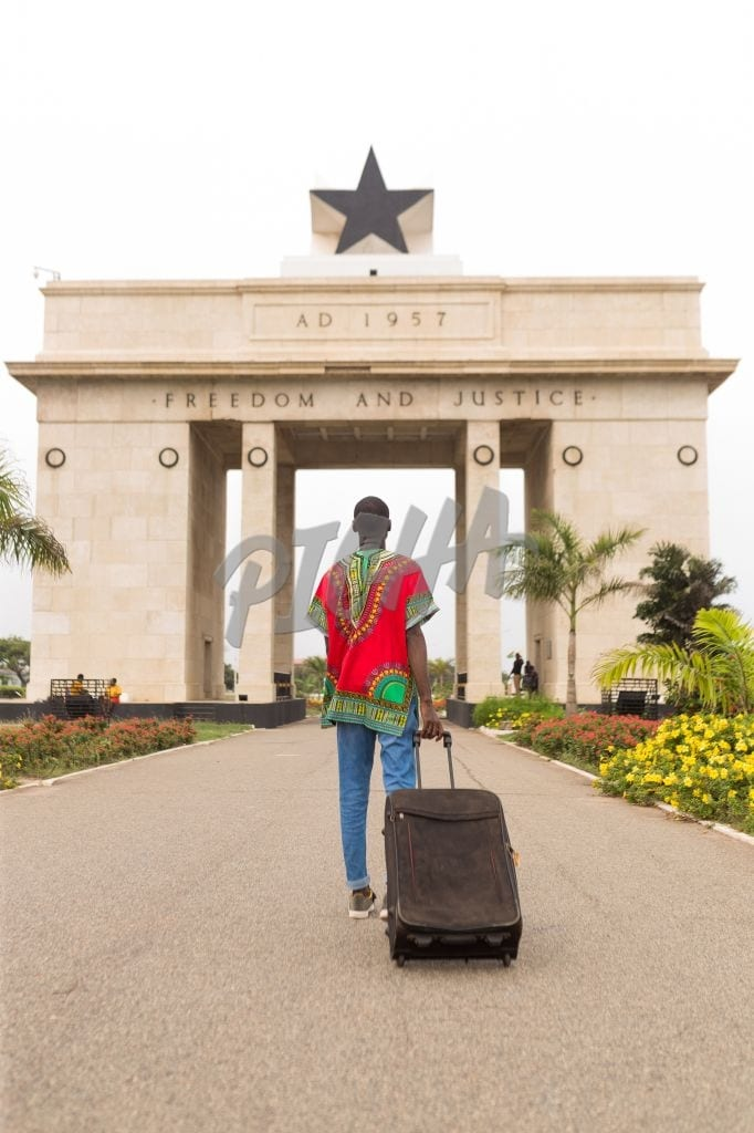 Man visiting the independence arch in Accra