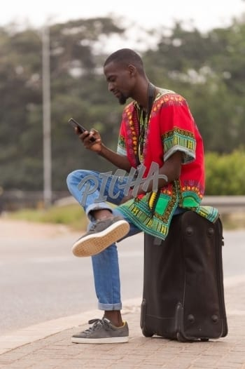 Man waiting for a taxi in Accra