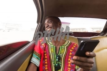 Man smiling in the car