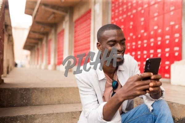 Man checking phone in Accra