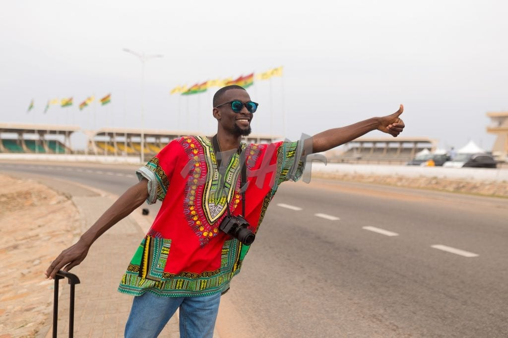 Man hailing for a cab in  Accra