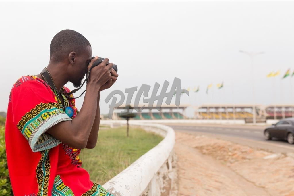 Man photographing monuments in Accra