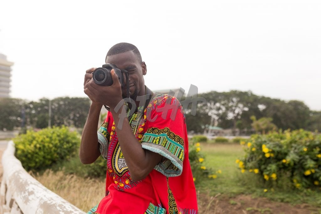 Man taking a photo in Accra