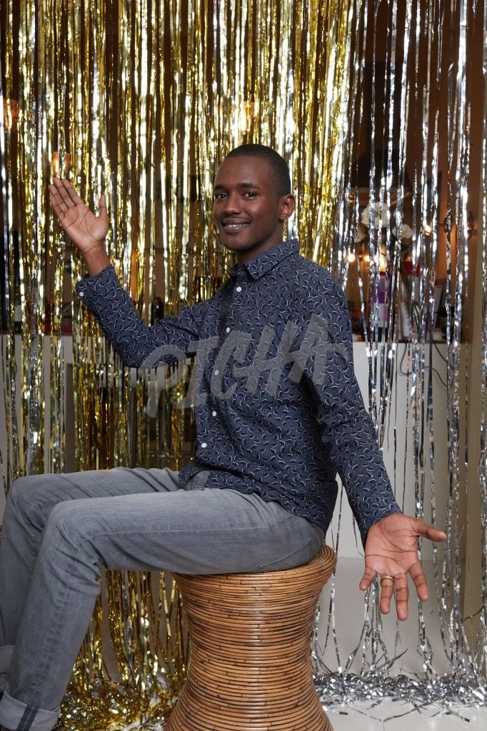 Man posing at a party