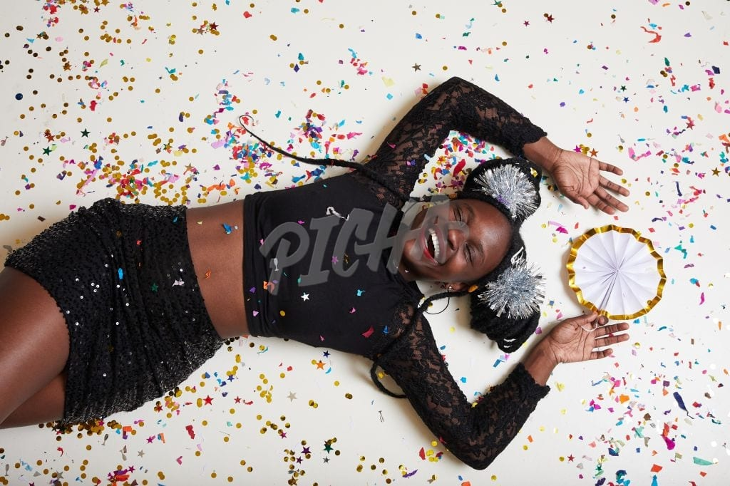Smily woman on confettis,2020 new year party