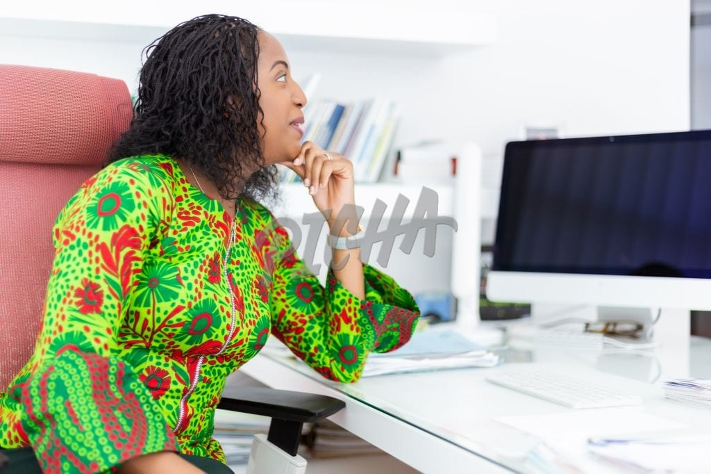 Woman sitting at her desk