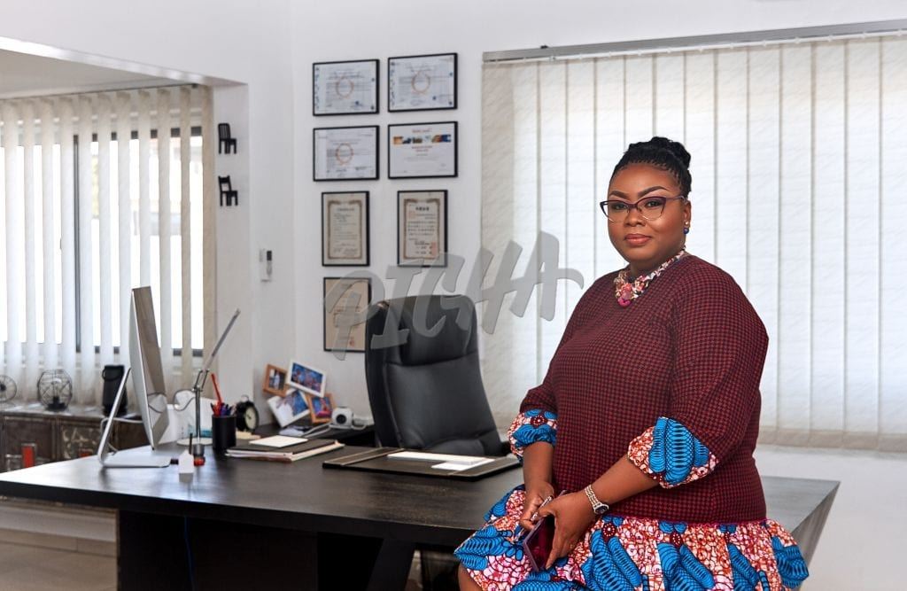 Powerful woman sitting by her desk