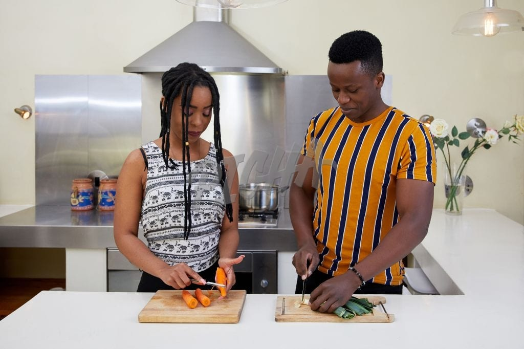 Couple prepare vegetables
