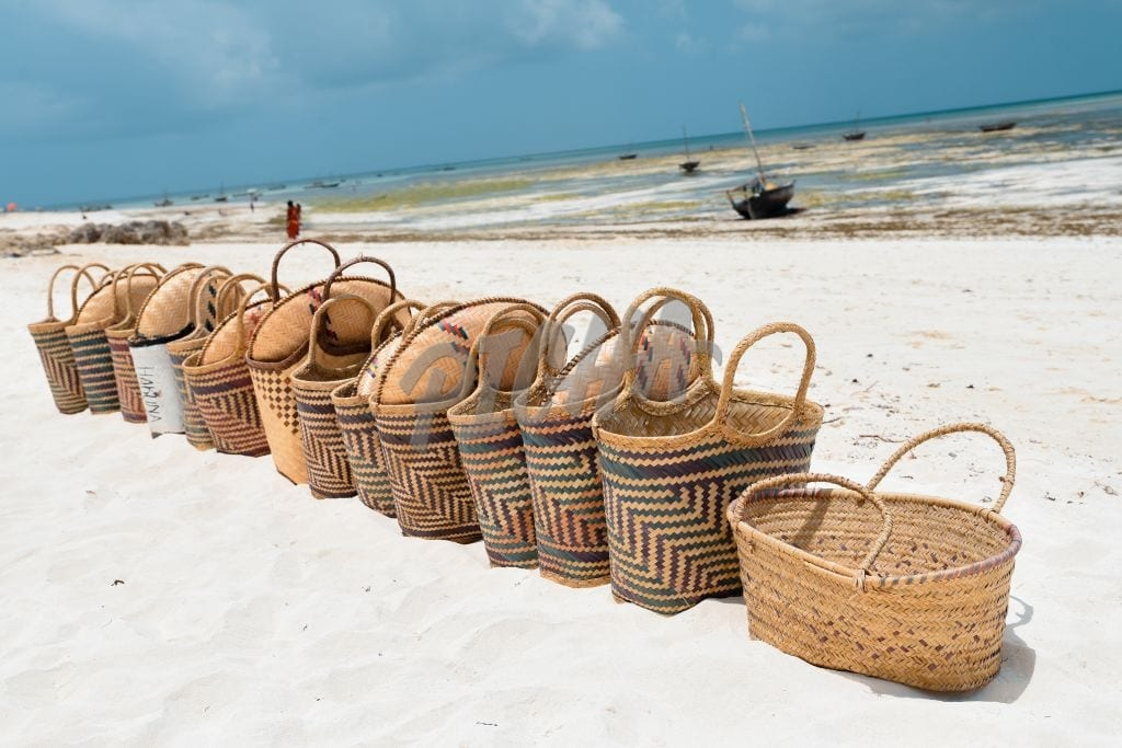 Woven baskets in a row on the beach