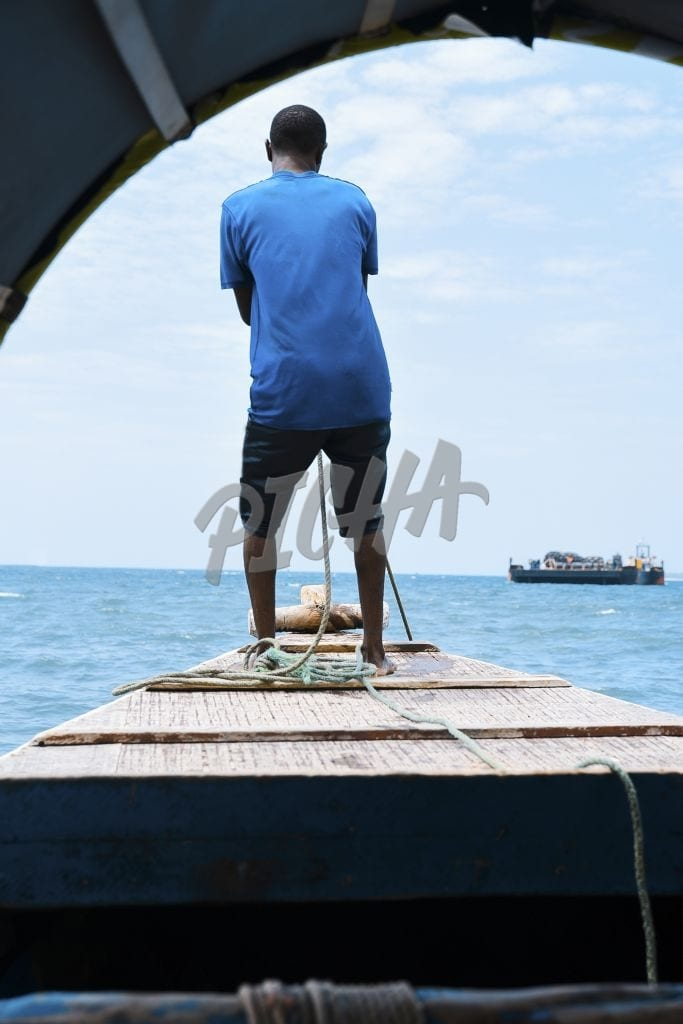 Man on the bow of the boat
