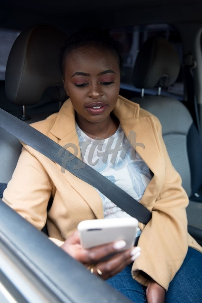 Woman checking phone in the car