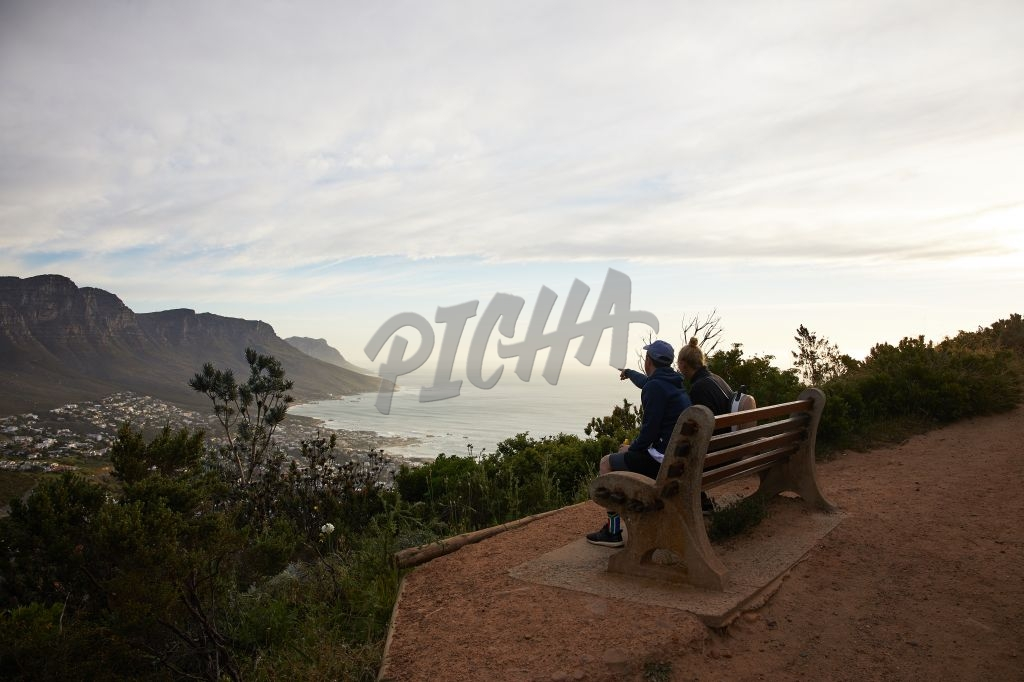 Couple admiring view of Camps Bay at sunset