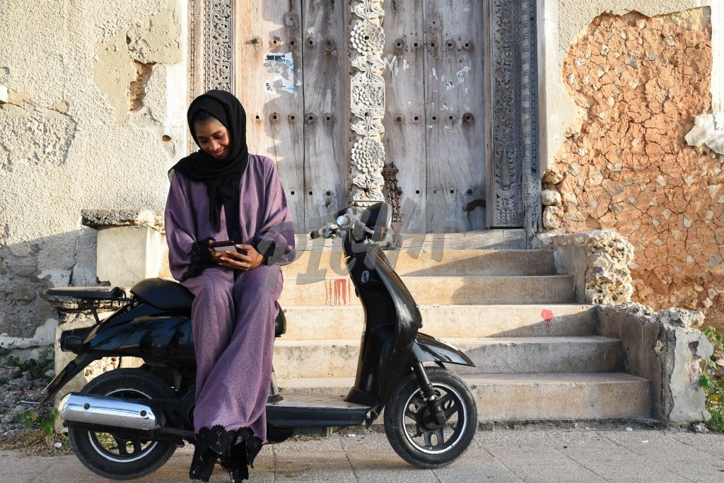 Girl in hijab using phone