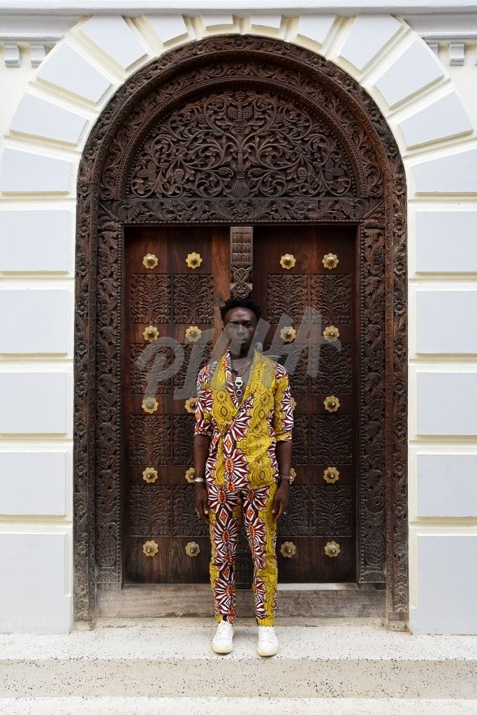 Man standing in front of a door