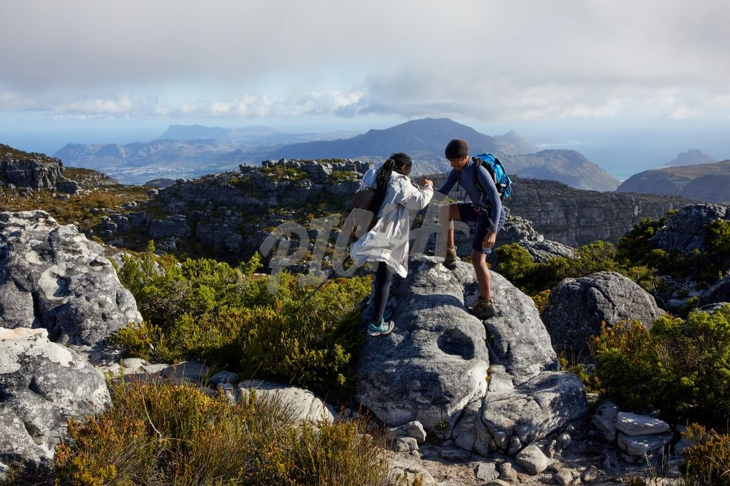 Climbing a rock on Table mountain