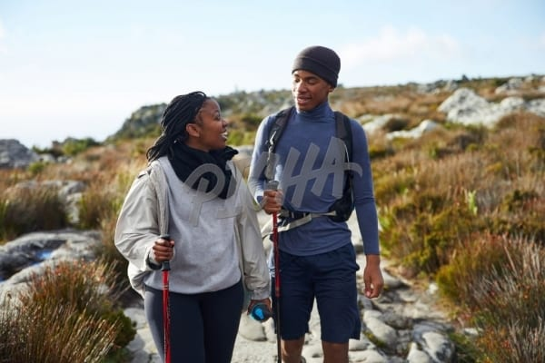 Friends chat while trekking