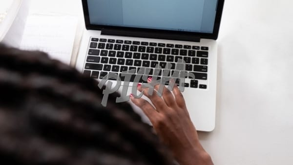 Red nails on a laptop
