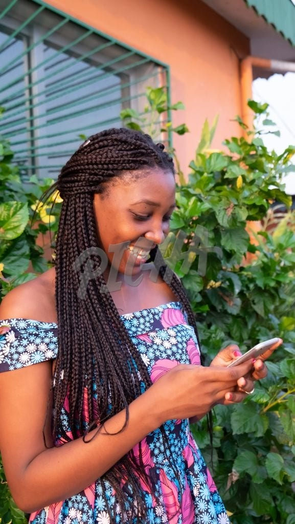 Lady smiles at her phone