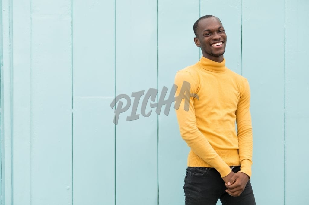 Man in yellow sweater