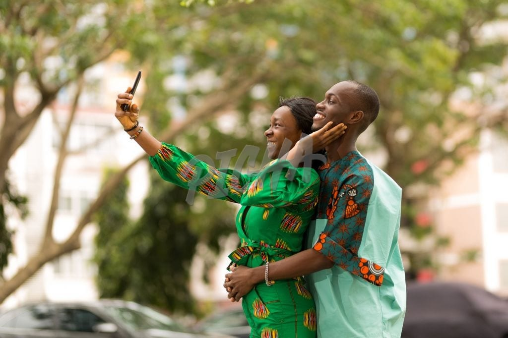 Stylish couple take a selfie