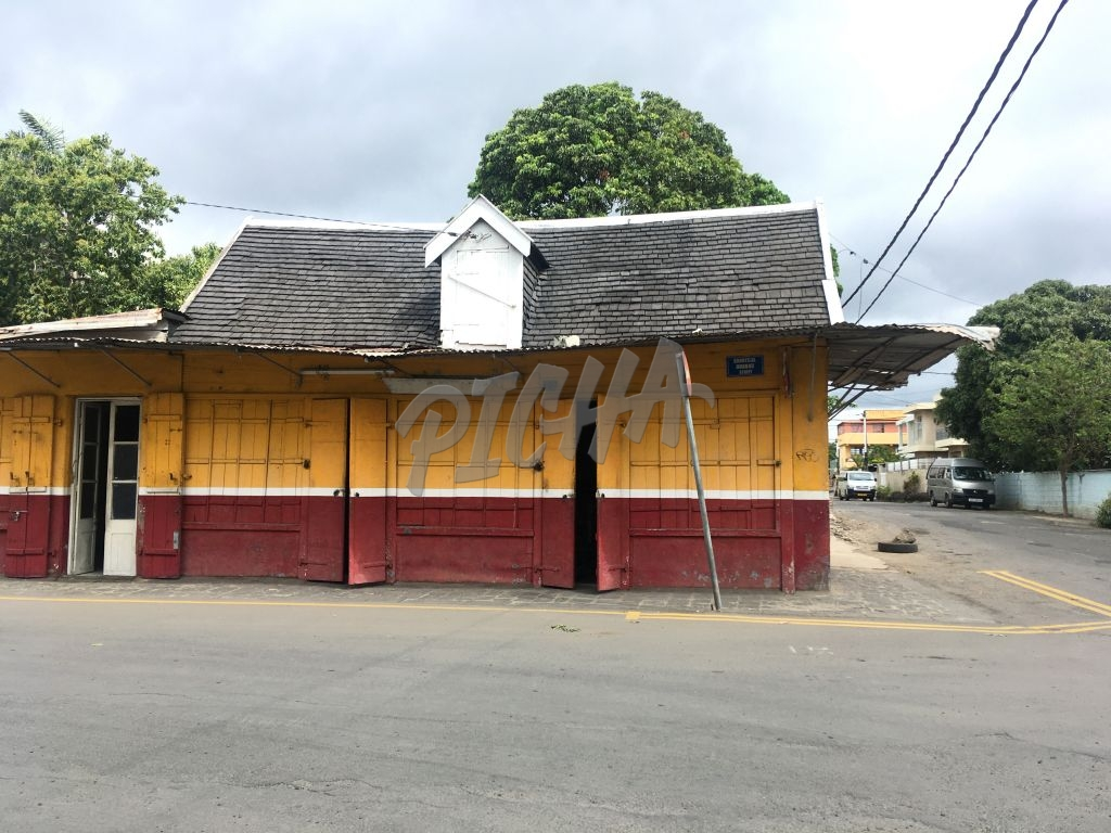 red yellow shop building in mauritius street