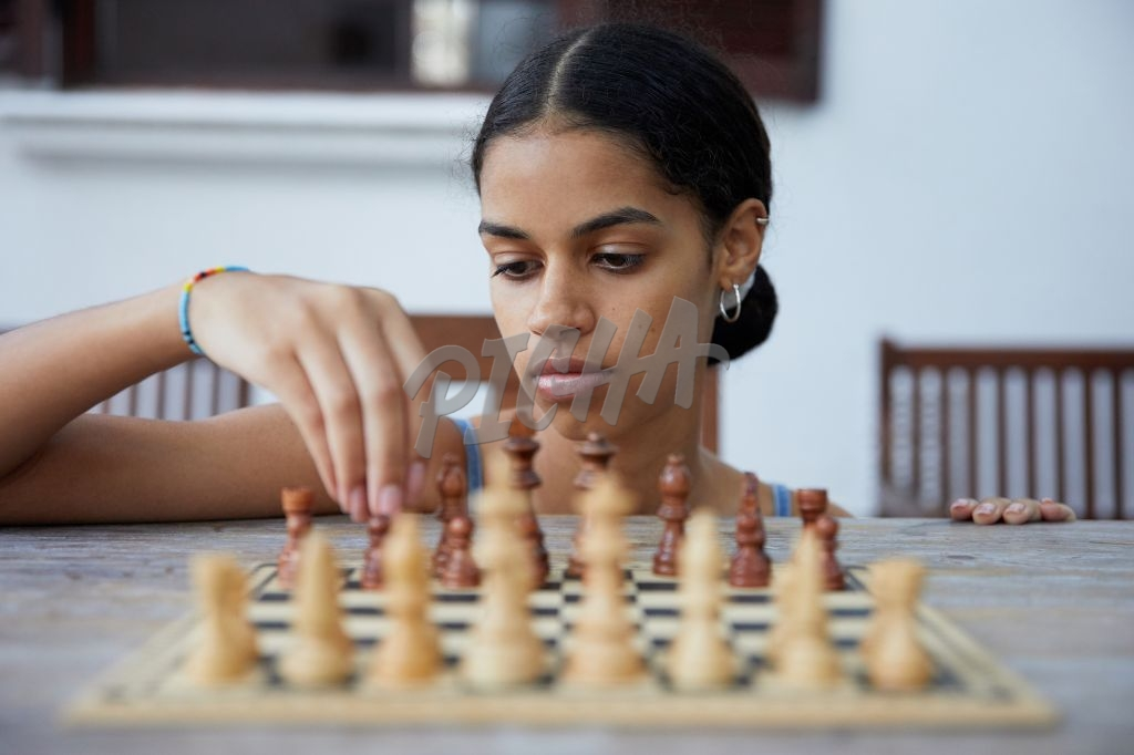 Smart girl playing chess