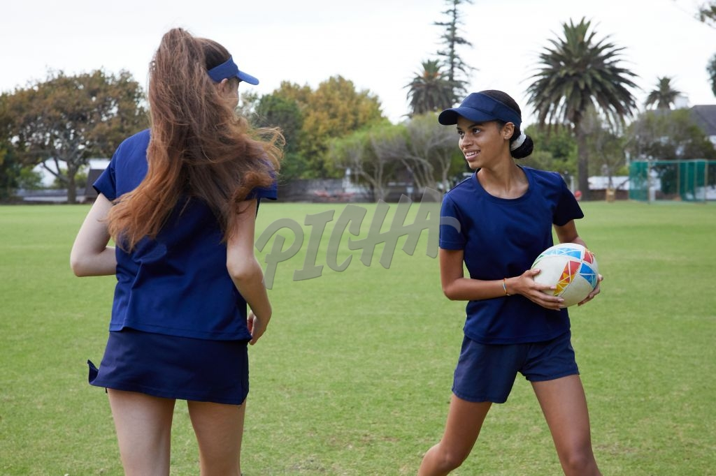 Teammates playing touch rugby