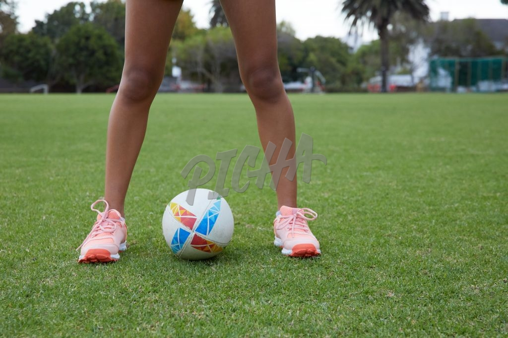 Standing over a rugby ball